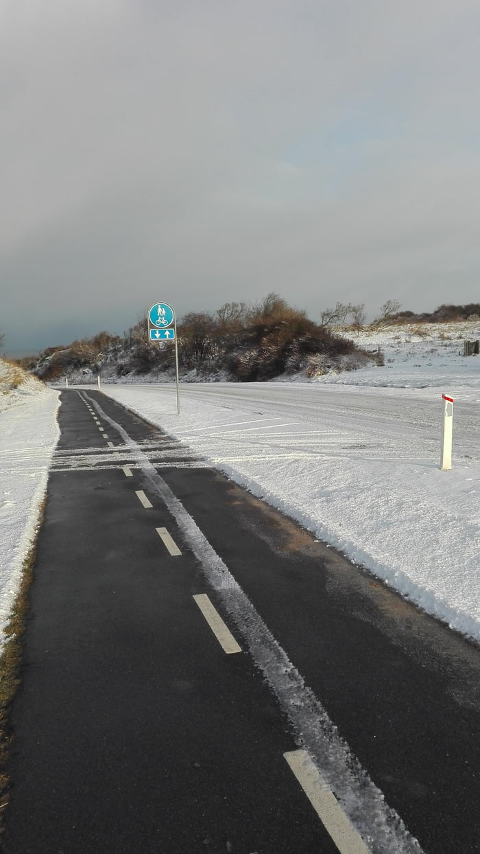 Winter in Denmark. The bike path has been cleared of snow, but the road hasn't