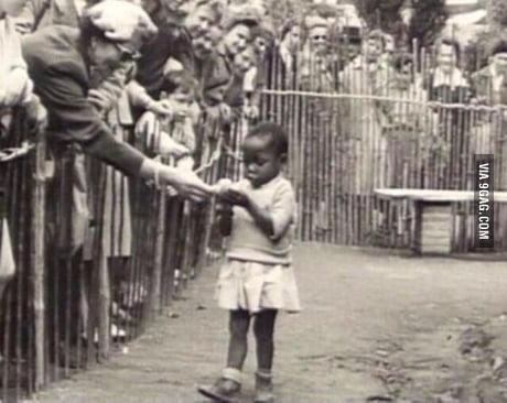 "An African girl on exhibit in a ""Human zoo"" in Belgium 1958"