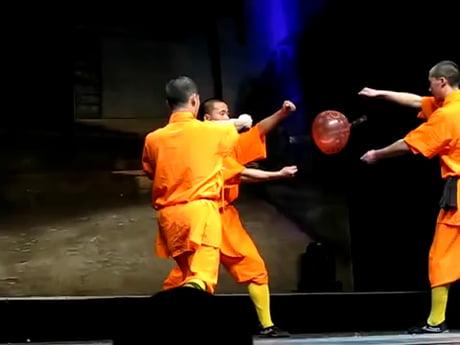 Shaolin Monk throws a needle through glass