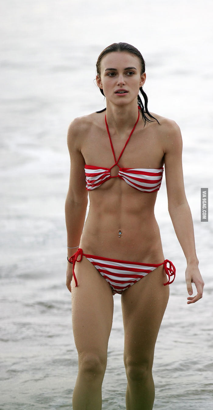 Keira Knightley looking very fit in a striped bikini.