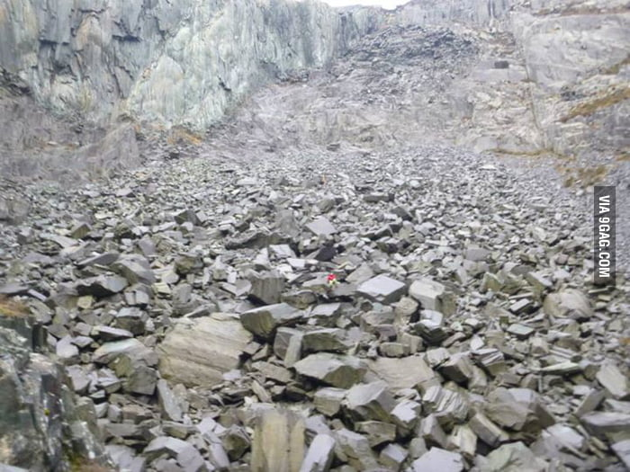 Was hiking in Wales, a very small part of an old abandoned Quarry. I'm the red thing.