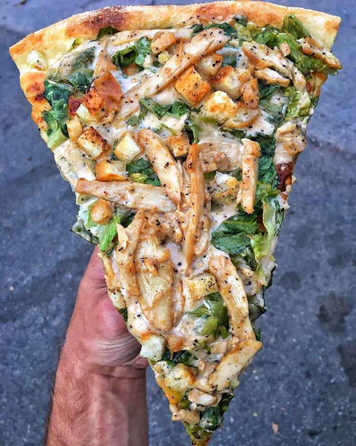 To all the people complaining about pineapple on pizza, here is a chicken Caesar salad pizza