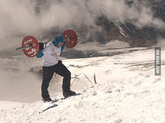 This Russian powerlifter climbed Europe's highest peak mount Elbrus (5642 m) carrying a 70-kg barbell on his back!