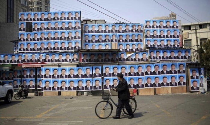 An old Chinese man covered his house with XiJinPing's photos to avoid forced demolition , and it's actually working