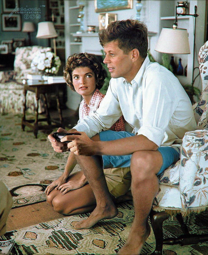 Jacqueline Kennedy waits for her turn as they have only one ps controller, 1960