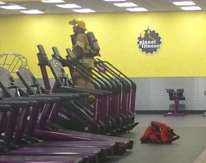 Firefighter fully suited climbing the amount of stairs in the WTC in honor of his fallen brothers