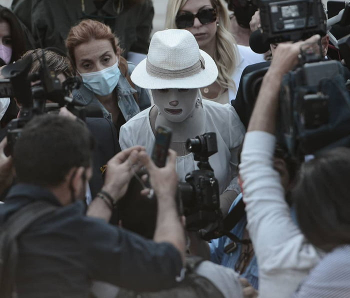 Acid attack victim in Greece arrives at the court to face her attacker. What a fighter.