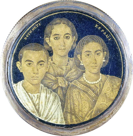Roman era(3rd-5th century AD) gold-glass portrait of a family from Alexandria, Egypt. Like all gold-glass protraits of the era, and despite its detail, it's a miniature portrait, only 6 cm in diameter