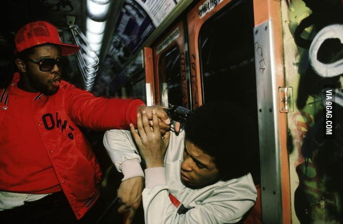 An undercover cop arresting a mugger on the New York subway. 1985