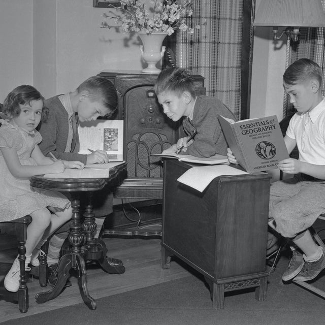 Kids remote learning during a polio outbreak in the 1940s. Teachers read lessons over the radio!