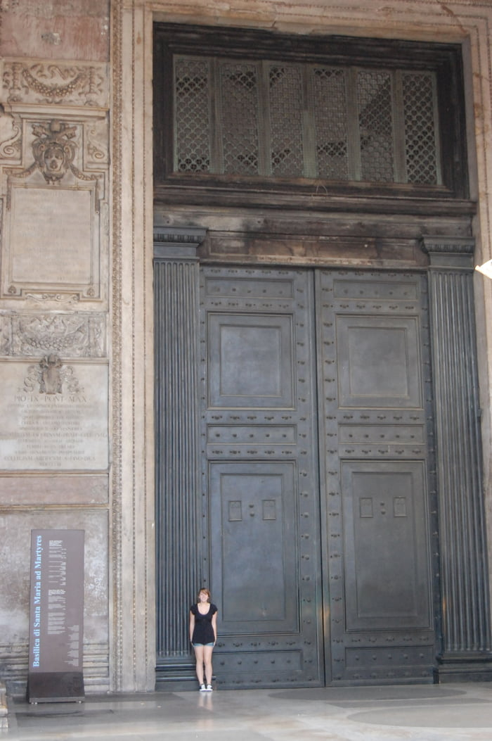 The oldest door still in use in Rome. Cast in bronze for emperor Hadrian' rebuilding, they date from about 115 AD. Human for scale.