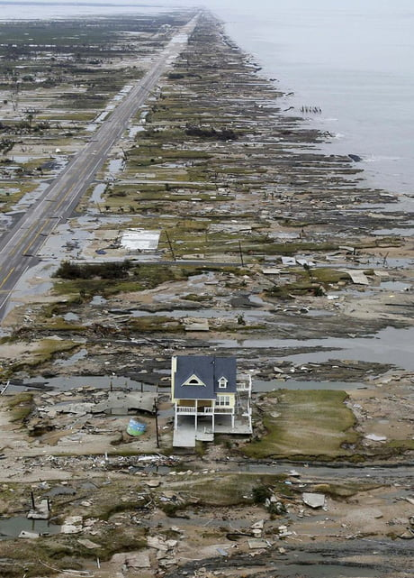 Awesome Helicopter pilot Ray Asgar's photo of Warren and Pam Adams home in Gilchrist, Texas after Hurricane Ike flattened everything around it.