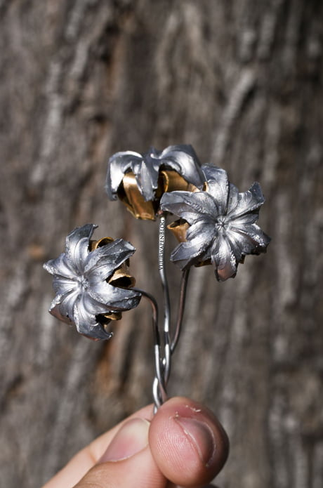 Awesome A bouquet of metal flowers made when hollow point bullets were shot underwater