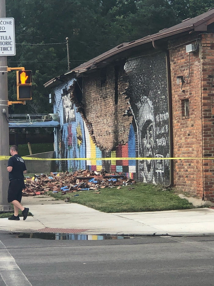 A lighting strike hits and destroys a mural of George Floyd.