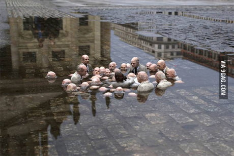 "This sculpture by Issac Cordal in Berlin is called ""Politicians discussing global warming."""