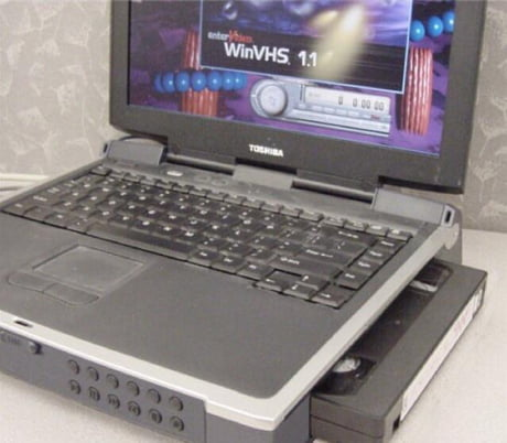 This old laptop has a VHS tape reader
