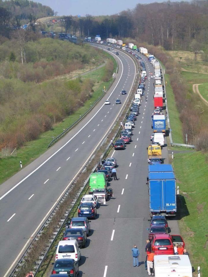 When traffic comes to a complete stop in Germany, the drivers, (by law) must move towards the edge of each side to create an open lane for emergency vehicles. . . Why don't we have these rules?