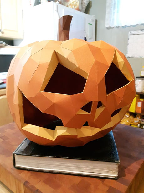 After 15 hours of folding, swearing and sticky fingers. This is my low poly jack o latern