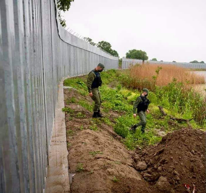 Greece has erected a 40 km fence and installed a new surveillance system on its border with Turkey in anticipation of a surge in Afghan refugees trying to reach Europe. Police patrol a steel wall at Evros river near the village of Poros at the Greece-Turkey border.