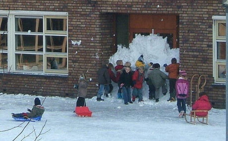 Kids blocking school front door with snow