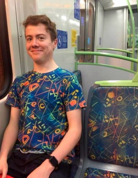 This guys shirt matches the bus seat.
