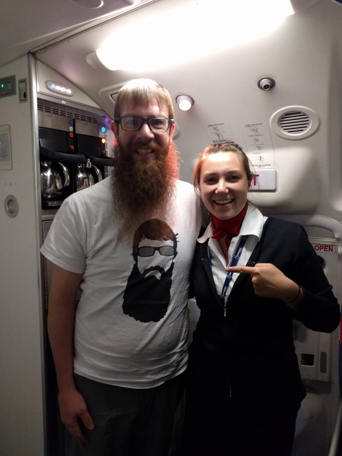This cool guy on my flight was wearing a tee-shirt of himself!