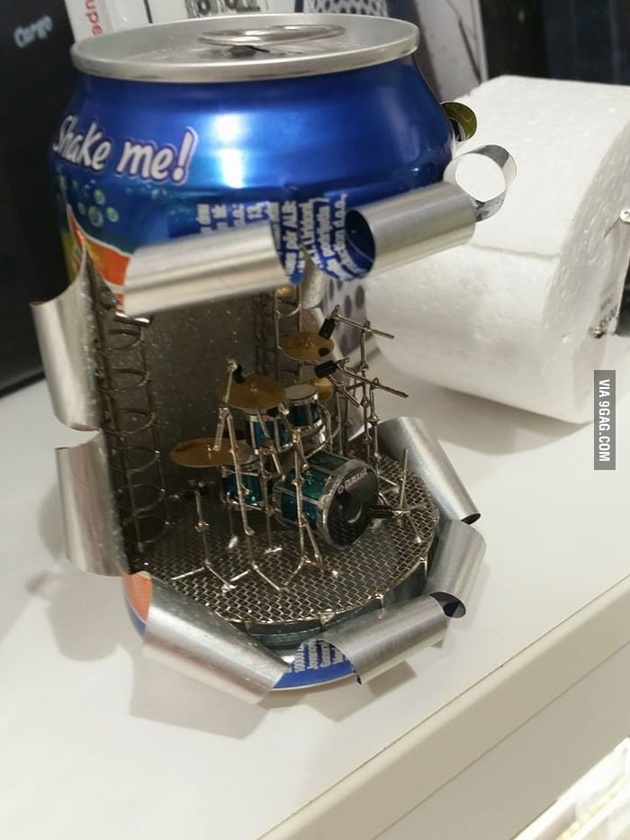 Some guy is making miniature drum sets in soda cans