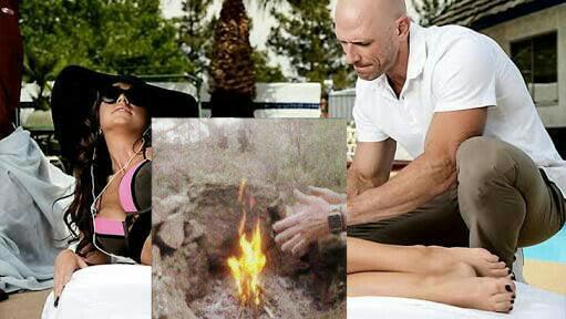 Johnny Sins apreciando a fogueira de acampamento