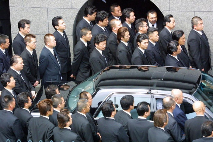A rare public funeral for a yakuza boss in Kobe, Japan.