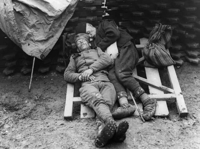 A Serbian soldier naps with his father who came to visit him on the front line near Belgrade, 1914/1915