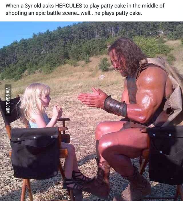 The Rock on set and in costume as Hercules playing patty cake with a 3 year old