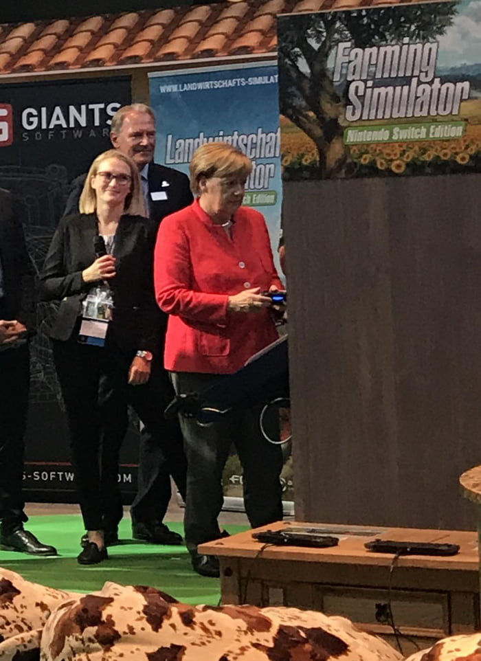 Angela Merkel playing Farming Simulator at GamesCom