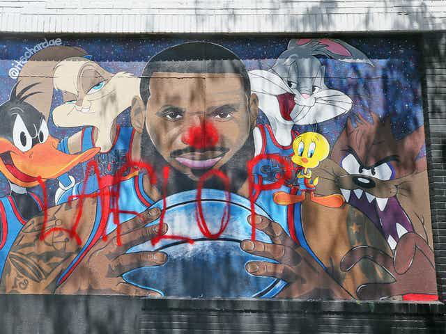 """Lebron James mural vandalized in his hometown. Red clown nose and """"LA FLOP"""""""