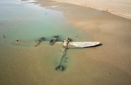 Sixty-five years after it crash-landed on a beach in Wales, an American P-38 fighter plane has emerged from the surf and sand where it lay buried 1