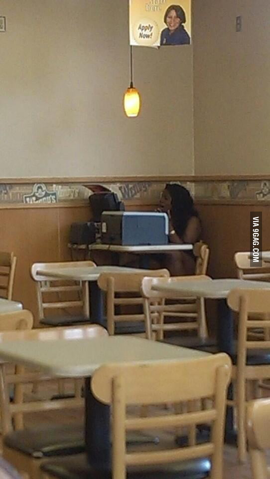 Lady taking full advantage of the free wifi at Wendy's