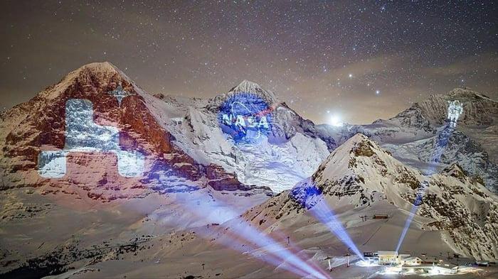 Switzerland celebrates the mars landing by projecting NASA images onto the mountain range.